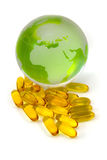 Cod Liver Oil and world globe. Fish Oil and world on isolated  White Background Royalty Free Stock Photo