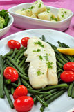 Cod loins with  beans and tomato Stock Photography