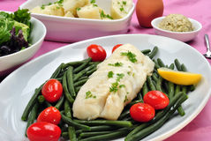 Cod loins with beans and tomato Stock Images