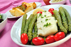 Cod loins with green asparagus and tomato Royalty Free Stock Photo