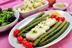Cod loins with green asparagus and tomato Stock Images