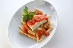 cod loins with home made tomato sauce Royalty Free Stock Images