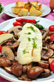 Cod loins with mushroom on a plate Stock Images