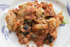Cod with olives capers and tomato sauce Stock Image