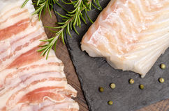 Cod and pancetta lard Stock Images