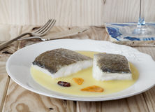 Cod with Pil Pil Sauce, Basque cookery. Royalty Free Stock Photos