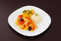 Cod a Portuguese style, rice and steamed vegetables Royalty Free Stock Photography