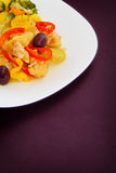 Cod a Portuguese style, rice and steamed vegetables Stock Photography