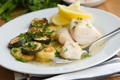 Cod with potatoes and courgettes Stock Photo