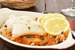Cod Provencal. With rice and ratatouille and lemon slices royalty free stock photos