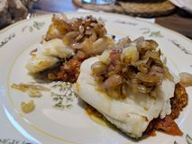 Codfish with shallots royalty free stock photos