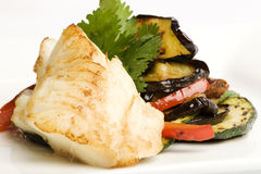 Cod with a side of eggplant and peppers Stock Image