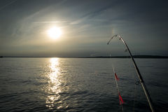 Cod summer fishing at sunset Royalty Free Stock Photography