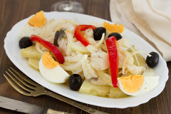 Cod with vegetables, olives and egg Royalty Free Stock Photography
