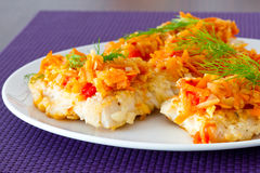 Cod with vegetables on the plate. Fried cod with vegetables for dinner Stock Photo