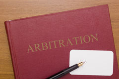 Code of Arbitration. The book and business card for a lawyer Royalty Free Stock Photo
