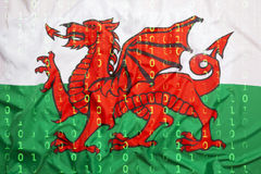 Code binaire avec le drapeau du Pays de Galles, concept de protection des données Photo libre de droits