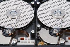 Code binaire sur deux HDD Photographie stock
