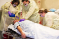Code blue team resuscitating a patient Royalty Free Stock Images