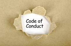 Code of conduct word written on torn paper. Concept royalty free illustration