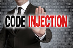 Code injection with matrix is shown by businessman stock image