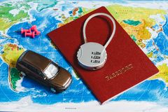 Code Lock on Red Passport, Toy Car, Pushpins on World Map Background. Concept-Ban on Travel, Lack of Visa. Code Lock on Red Passport, Toy Car, Pushpins on World stock photos