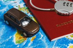 Code Lock on Red Passport, Toy Car, Pushpins on World Map Background. Concept-Ban on Travel, Lack of Visa. Code Lock on Red Passport, Toy Car on World Map stock image