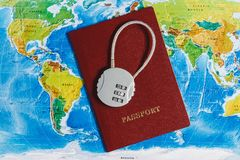 Code Lock on Red Passport on World Map Background. Concept-Ban on Travel, Lack of Visa. Code Lock on Red Passport on World Map Background. Concept-Ban on Travel royalty free stock photos