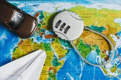 Code Lock, Toy Car, Papercraft Plane on World Map Background. Concept-Ban on Travel, Lack of Visa. Code Lock, Toy Car, Papercraft Plane on World Map Background stock photos