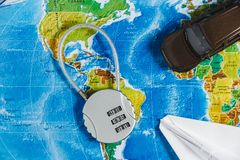 Code Lock, Toy Car, Papercraft Plane on World Map Background. Concept-Ban on Travel, Lack of Visa. Code Lock, Toy Car, Papercraft Plane on World Map Background stock images