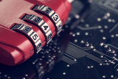 Code numbers on combination pad lock on computer circuit board w. Ith solder, digital cyber safety or security encryption concept, technology to encode online Stock Photos
