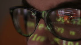 Code Reflection In Hackers Glasses. Hacker coding in dark room.