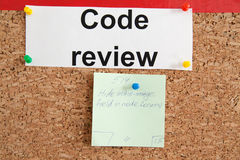 Code review task. Code review section with pinned paper ticket on cork kanban board Royalty Free Stock Photos