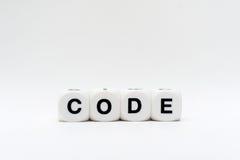 Code, Würfelbuchstaben Stockbild