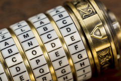 Code word as password. Code word as a password to combination puzzle box with rings of letters Royalty Free Stock Photo