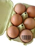 Coded Egg. Egg-box with 6 fresh eggs, one of them with a bar-code Stock Photography