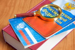 Codes of laws of the Russian Federation and magnifier Royalty Free Stock Photo