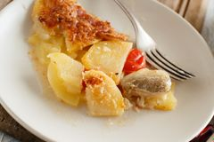 Codfish with potatoes. Codfish or baccala with potatoes cooked in the oven Stock Photography
