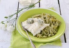 Codfish fillet and pasta Royalty Free Stock Photography