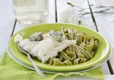 Codfish fillet and pasta Stock Photos
