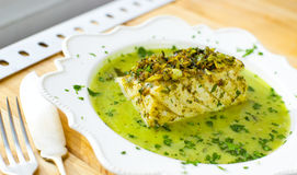 Codfish in green sauce. Stock Photo