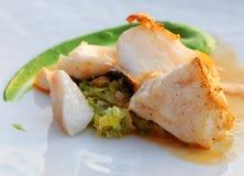 Codfish with leek brunoise Royalty Free Stock Photo