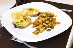Codfish with mushrooms    on  plate Stock Images