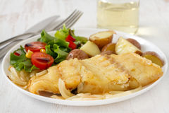 Codfish with potato. And vegetable salad Royalty Free Stock Photography