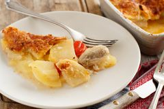 Codfish with potatoes. Codfish or baccala with potatoes cooked in the oven Stock Photo