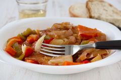 Codfish stew with wine. Codfish stew with glass of wine Stock Photos
