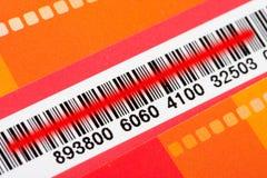Codice a barre con il laser rosso dello scanner Fotografia Stock