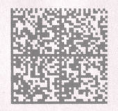 Codice a barre 2D su carta Fotografie Stock
