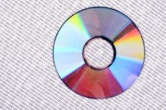Codice binario e DVD Fotografia Stock