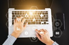 Coding software developer work with augmented reality dashboard computer icons. With responsive cybersecurity.Businessman hand working royalty free stock photography
